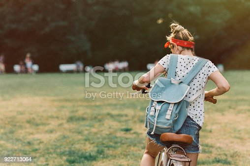 Woman riding a bicycle in the park.
