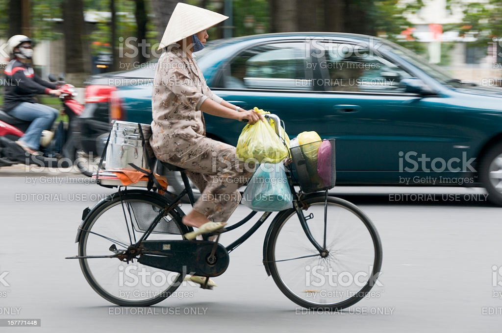 Woman Riding A Bicycle In Vietnam royalty-free stock photo