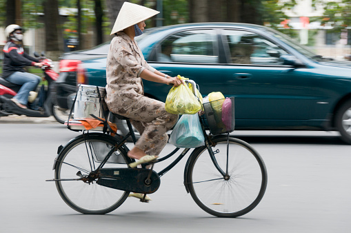 Woman Riding A Bicycle In Vietnam
