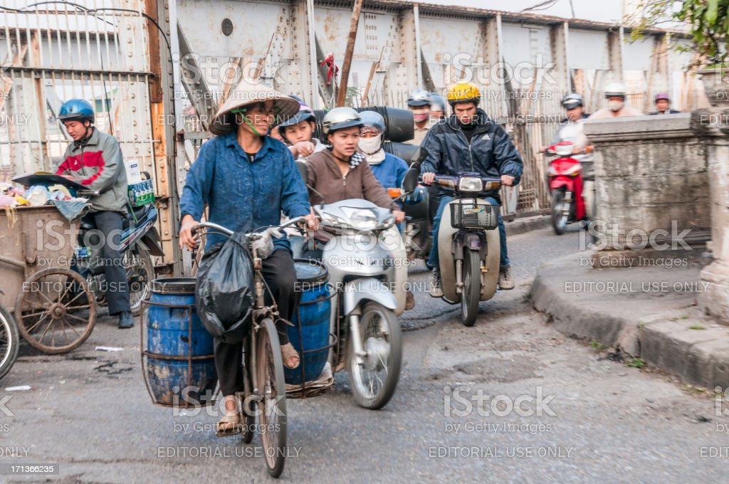 Woman Riding A Bicycle In Vietnam stock photo