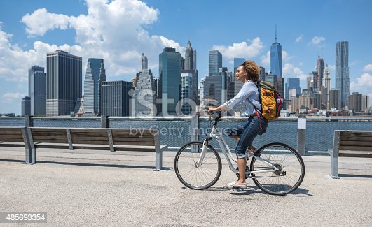 istock Woman riding a bike in NYC 485693354