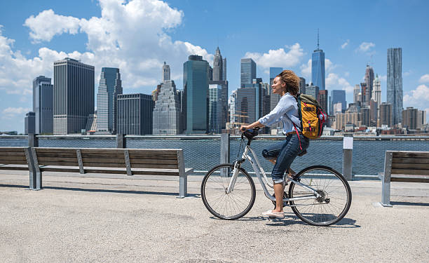 Woman riding a bike in NYC stock photo