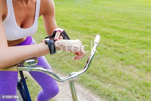 istock Woman riding a bike with a smartwatch heart rate monitor 816881966
