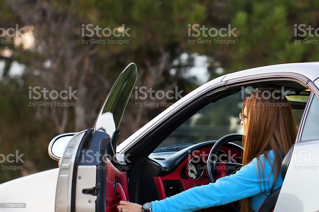 Woman riding a car stock photo