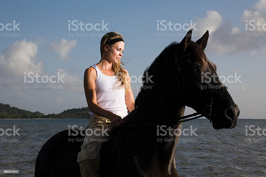 A woman riding a horse royalty-free stock photo