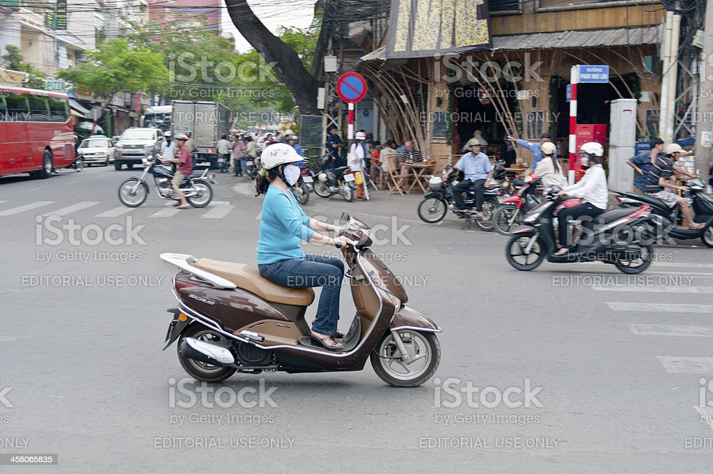 Woman Riding A Motorcycle In HCMC, Vietnam stock photo