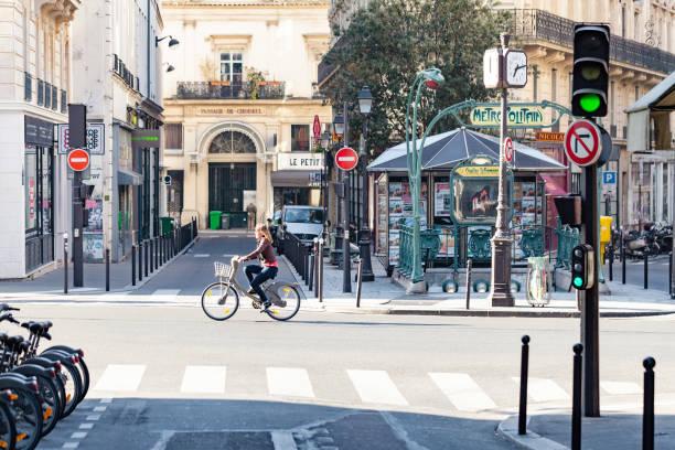 Woman riding a Velib bicycle in Paris stock photo