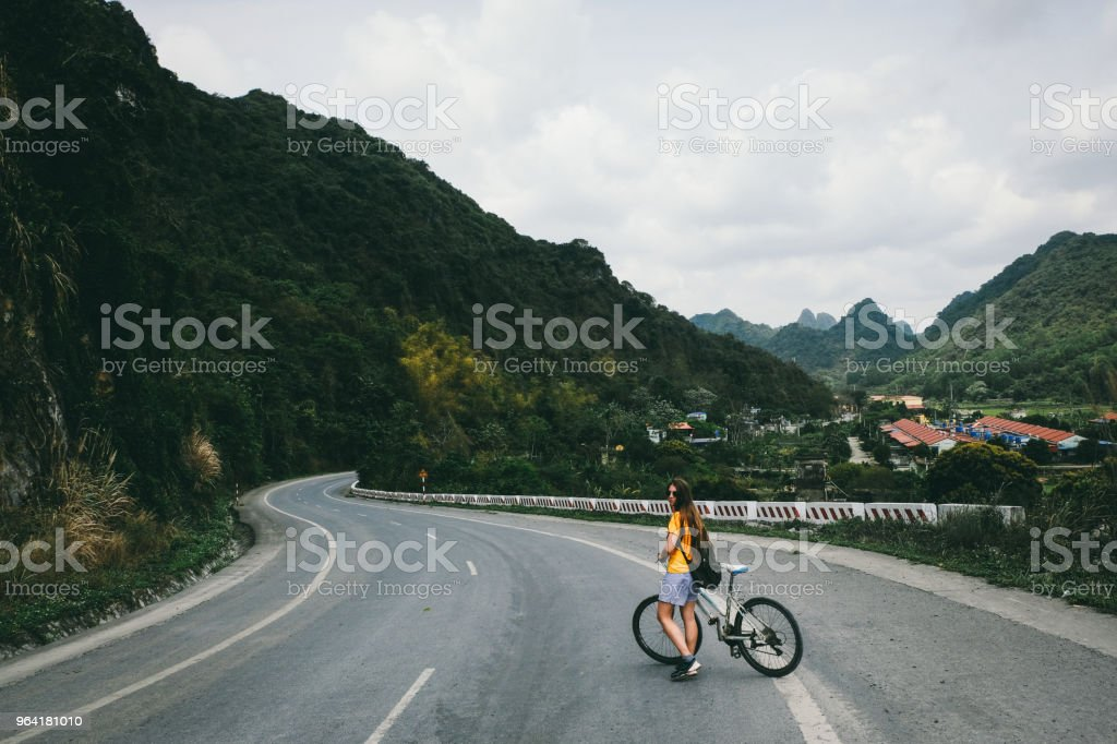 Woman Riding Bicycle On Cat Ba Island In Vietnam Stock Photo