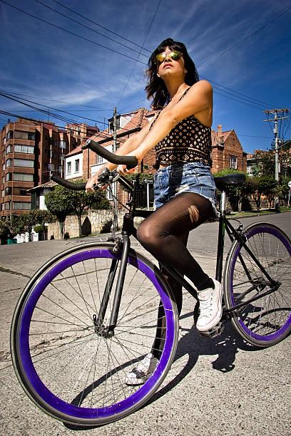 Woman riding bicycle stock photo
