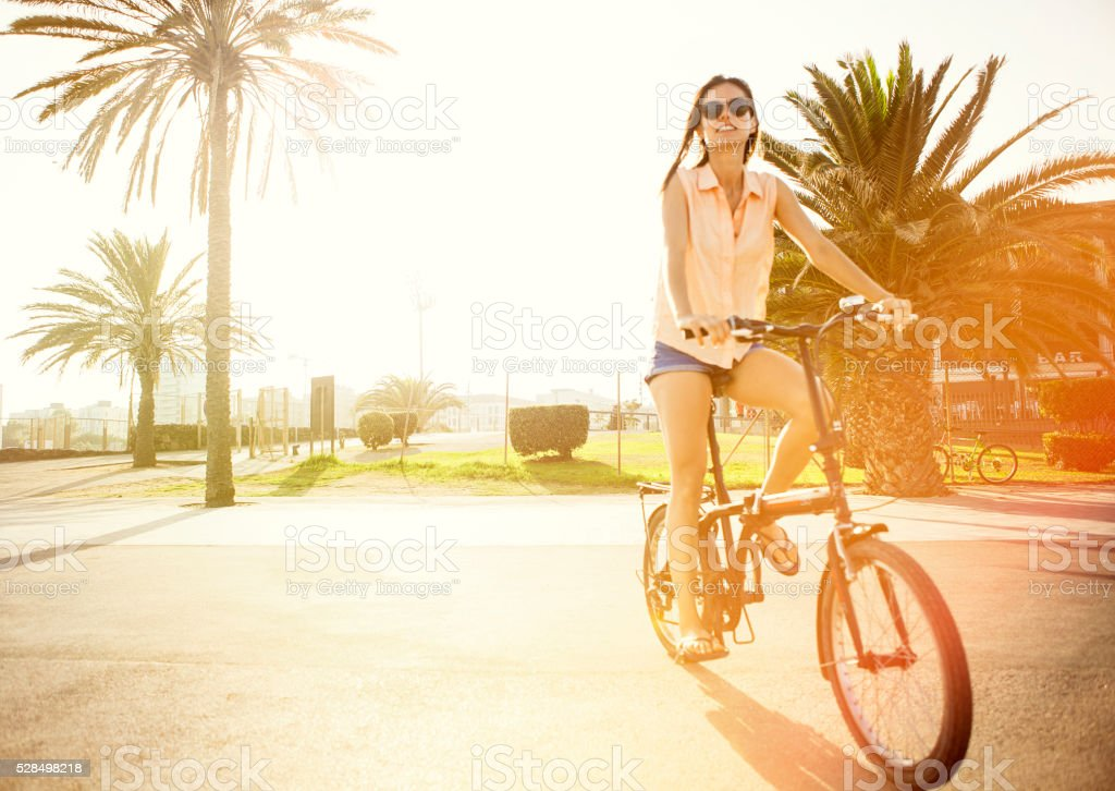 Woman riding bicycle stock photo
