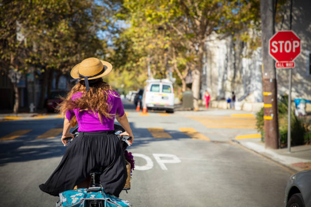 Woman Riding Caro Bike in San Francisco stock photo