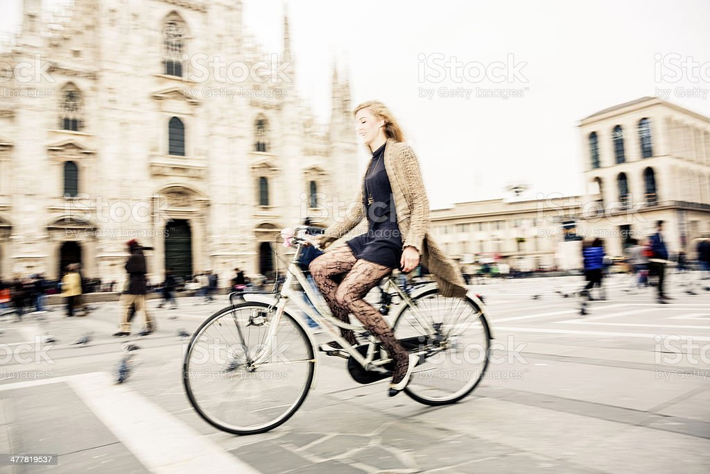 Woman riding her bicycle royalty-free stock photo