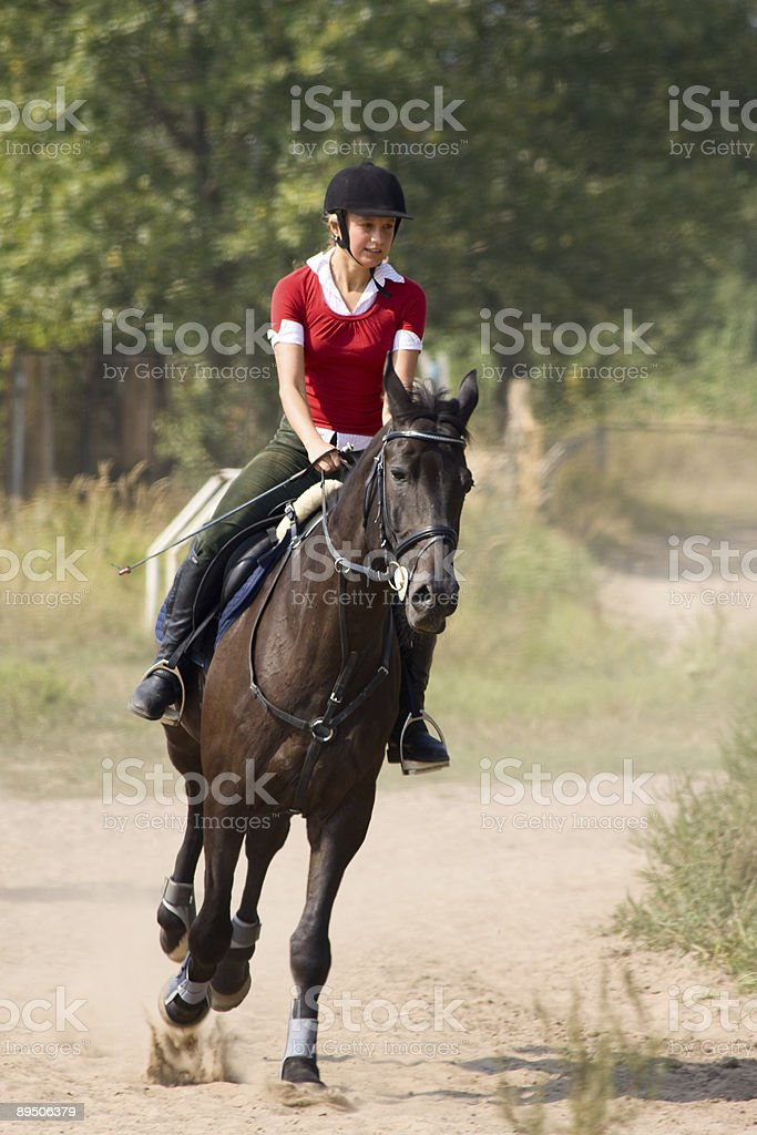 Woman riding horseback royalty-free stock photo