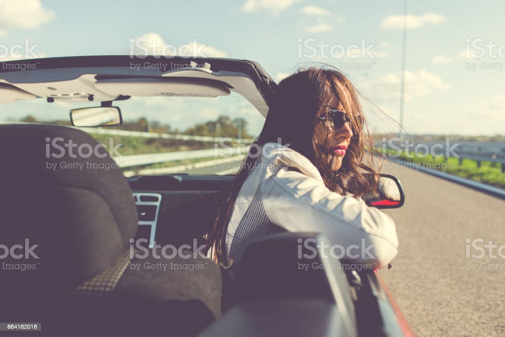 Woman riding in a sports car or cabriolet royalty-free stock photo