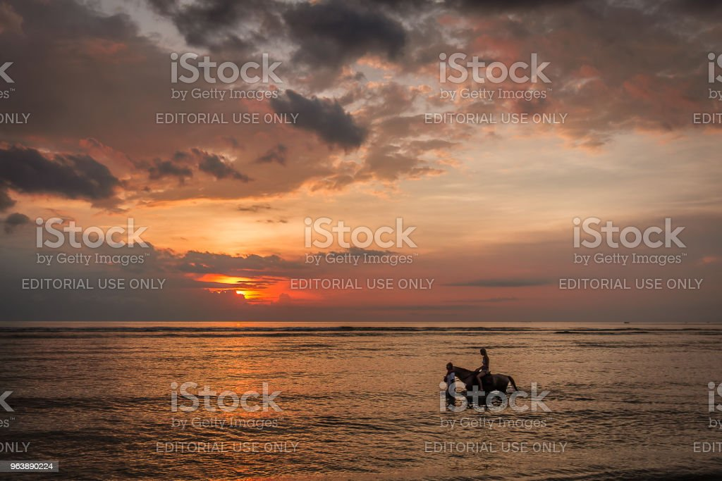 Woman riding in the sunset, - Royalty-free Activity Stock Photo