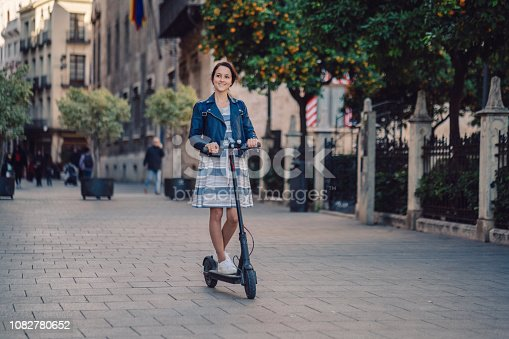 Tourist woman exploring Valencia on scooter