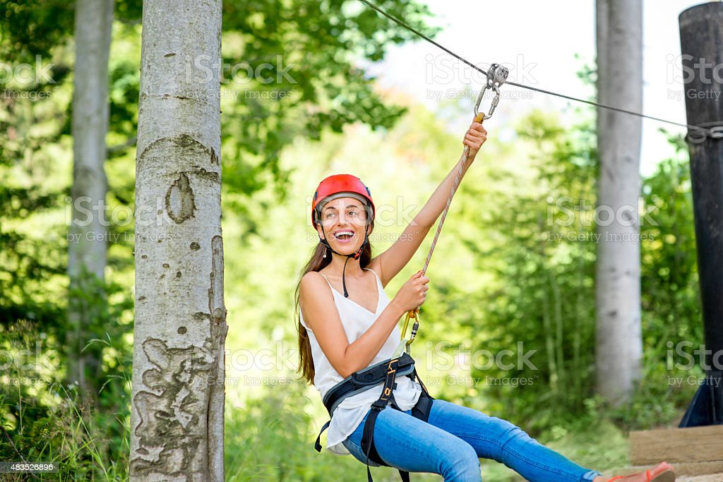 Woman riding on a zip line royalty-free stock photo
