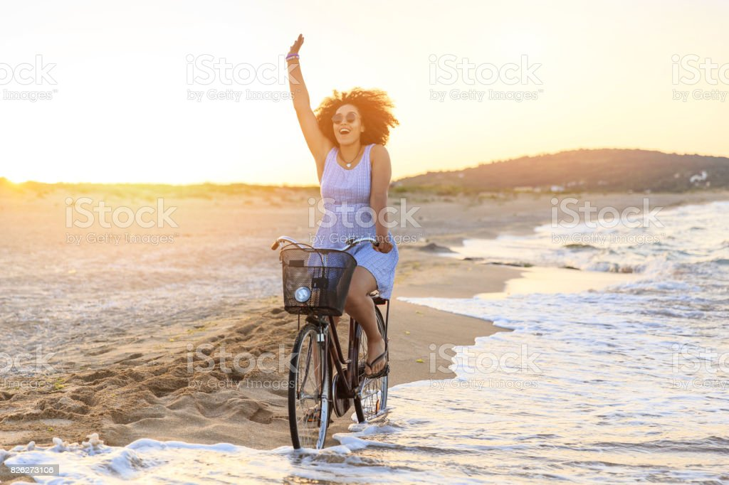 Woman riding on beach stock photo