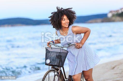 969233490 istock photo Woman riding on beach 828476336