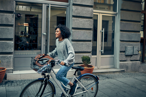 istock Woman Riding Rented Bicycle In A City 1045817838
