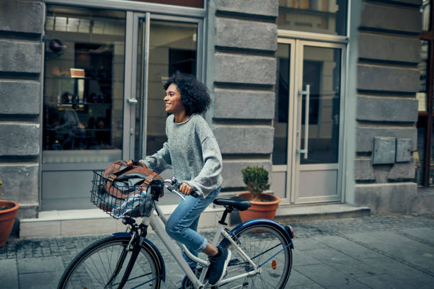 Woman Riding Rented Bicycle In A City stock photo