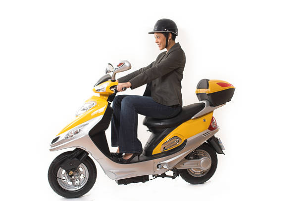 woman riding scooter stock photo