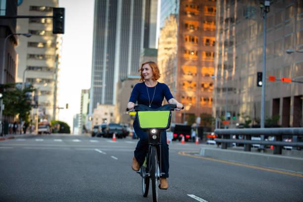 Woman Riding Share Bike in DTLA stock photo