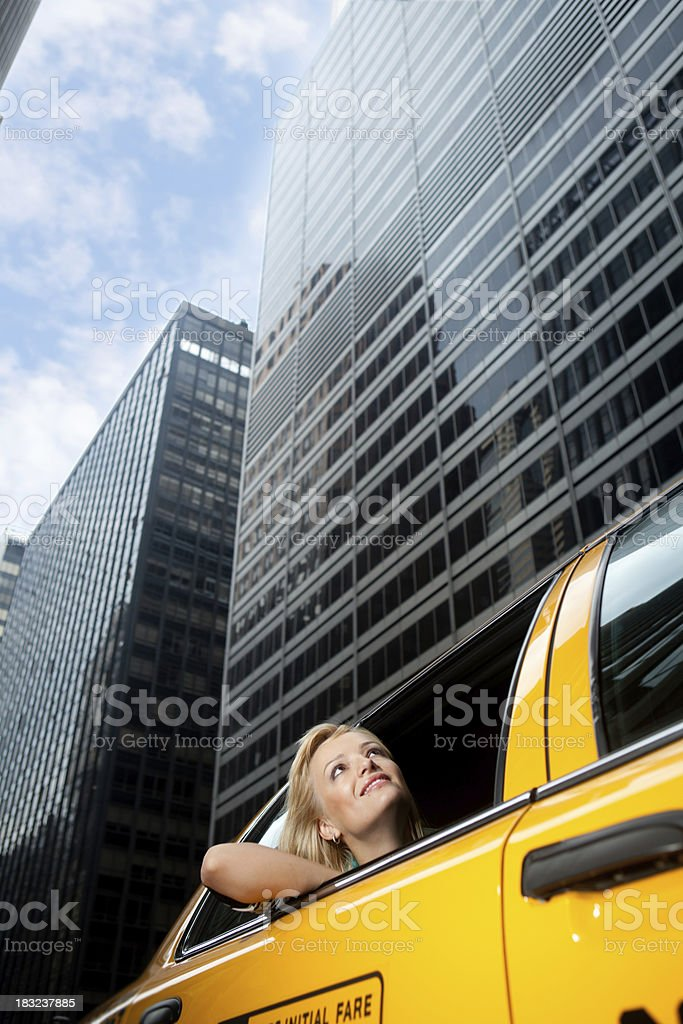 Woman riding taxicab in a New York City royalty-free stock photo