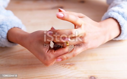 istock woman ring divorce 1086334418
