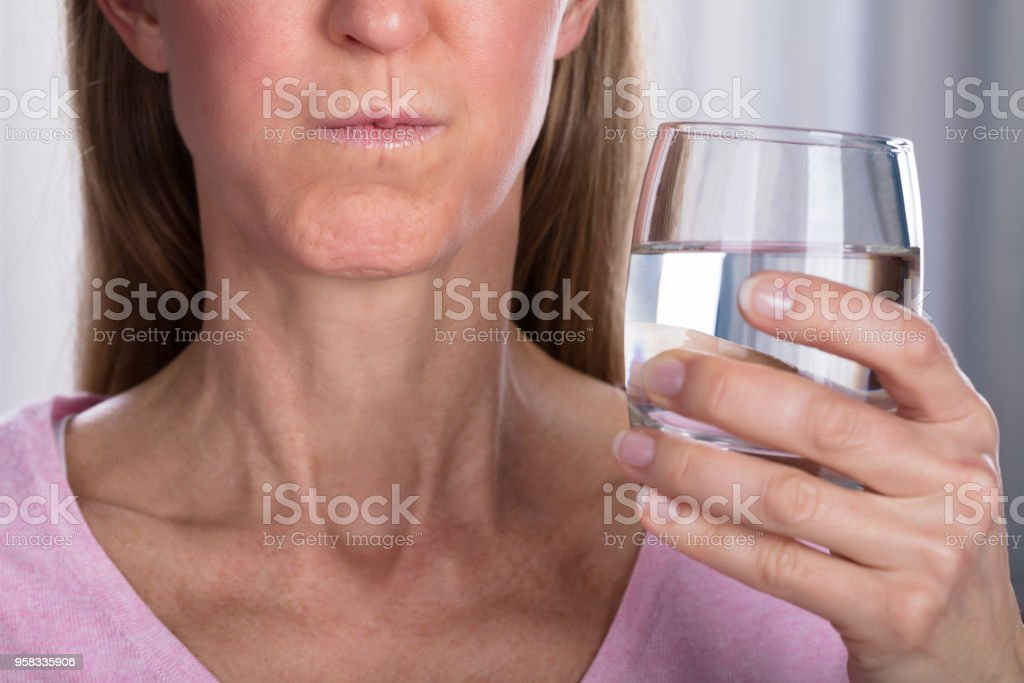 Woman Rinsing And Gargling With Water stock photo
