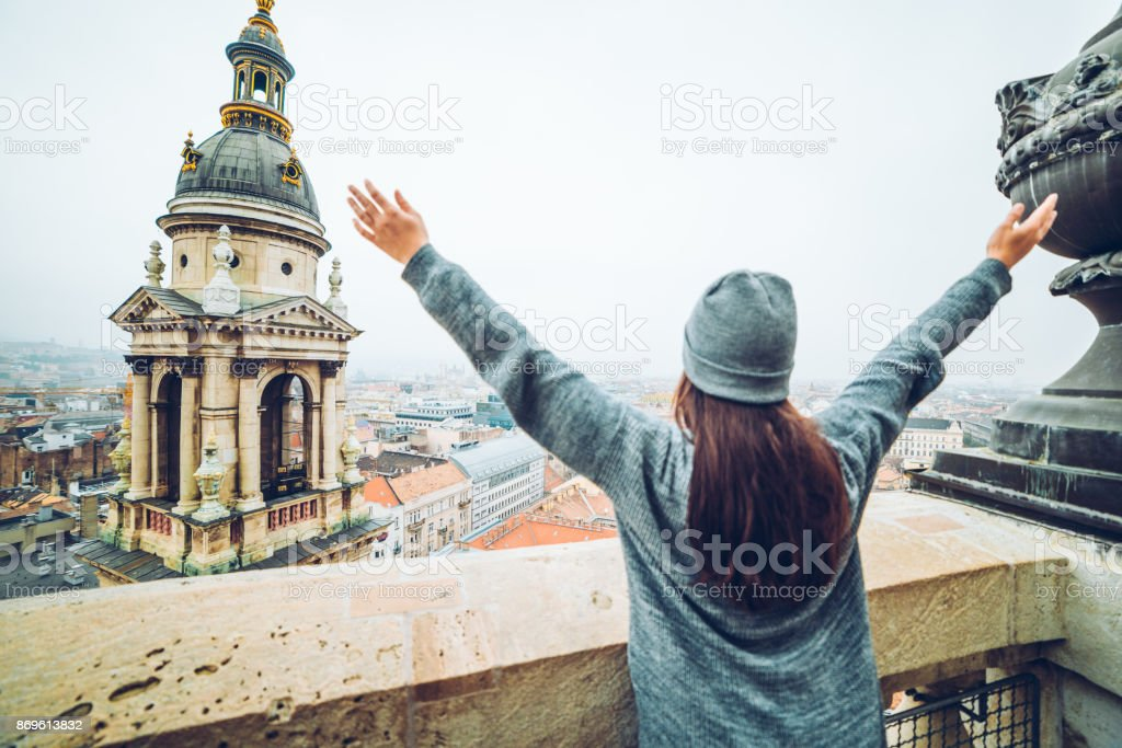 woman rise hand up with beautiful view at old european city stock photo