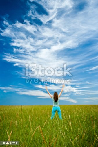 istock woman rising up hands 104718291