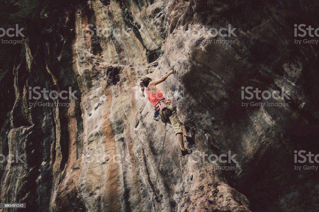 Woman rock climber at Railay Beach, Krabi, Thailand