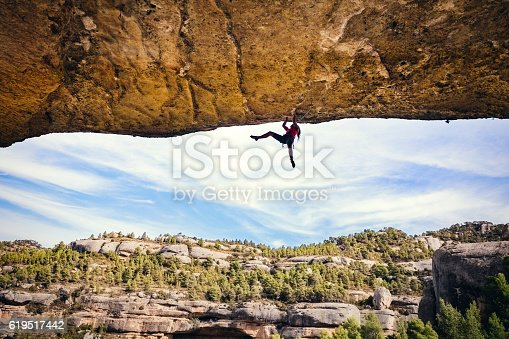Woman rock climbing in Margalef Catalonia Spain