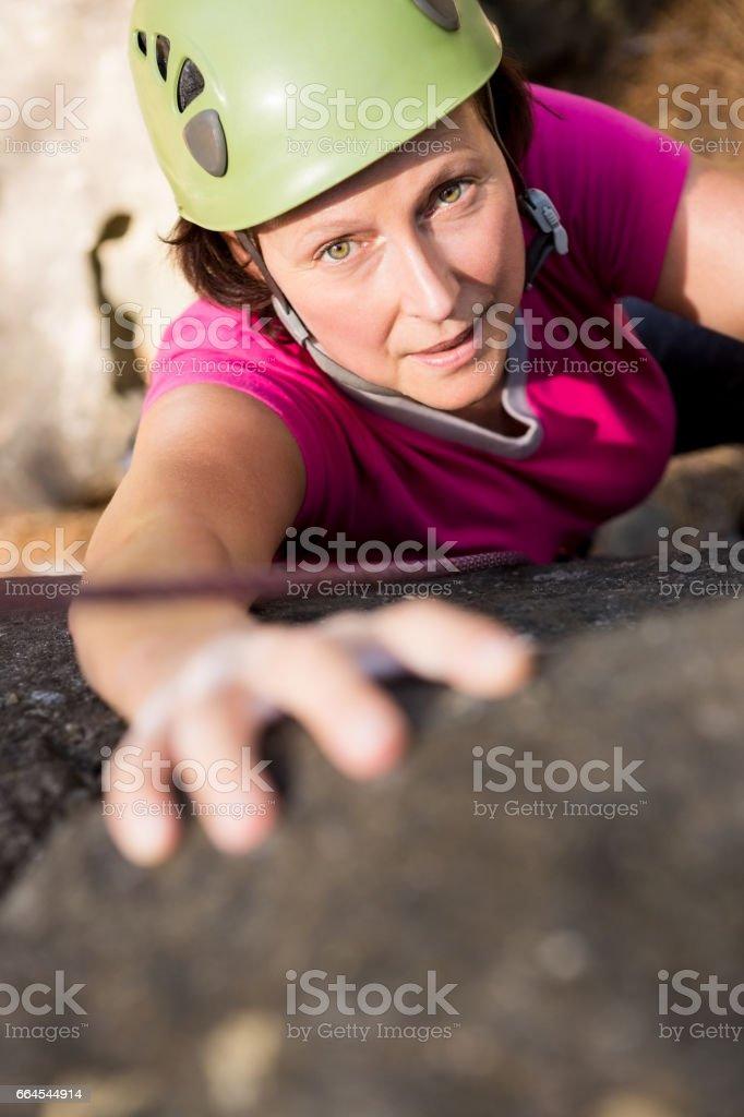 Woman rock climbing royalty-free stock photo
