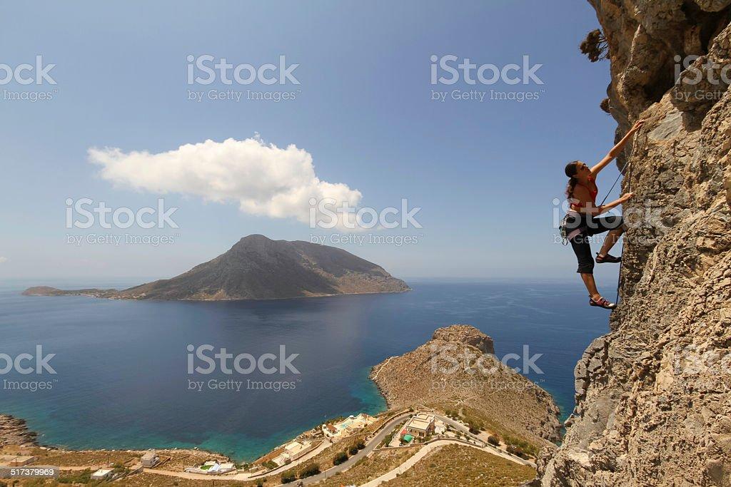 Woman rockclimbing in Kalymnos stock photo