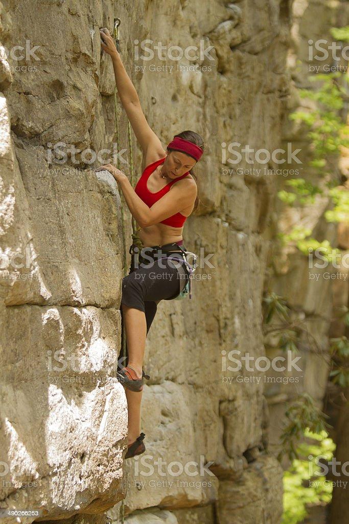 Woman rockclimbing in USA stock photo