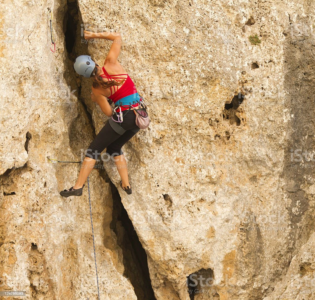 Woman rockclimbing royalty-free stock photo