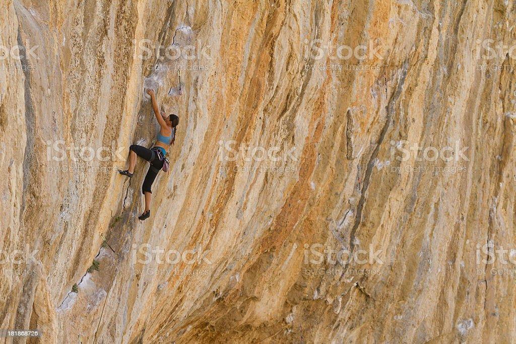 Woman rockclimbing stock photo