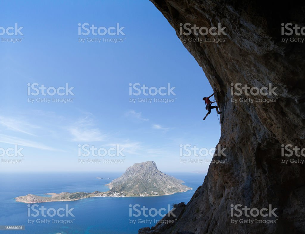 Woman rockclimbing silhouette stock photo