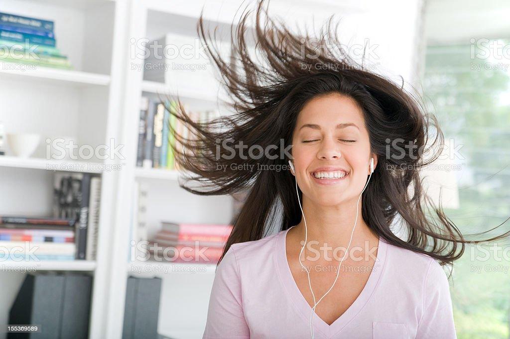 Woman rocking to music royalty-free stock photo