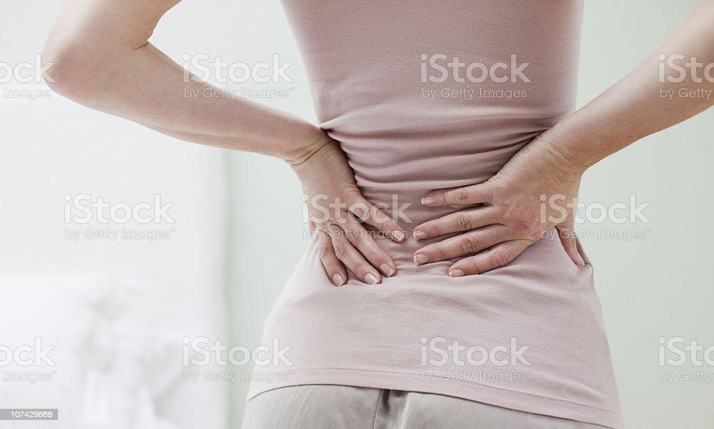 Woman rubbing aching back stok fotoğrafı