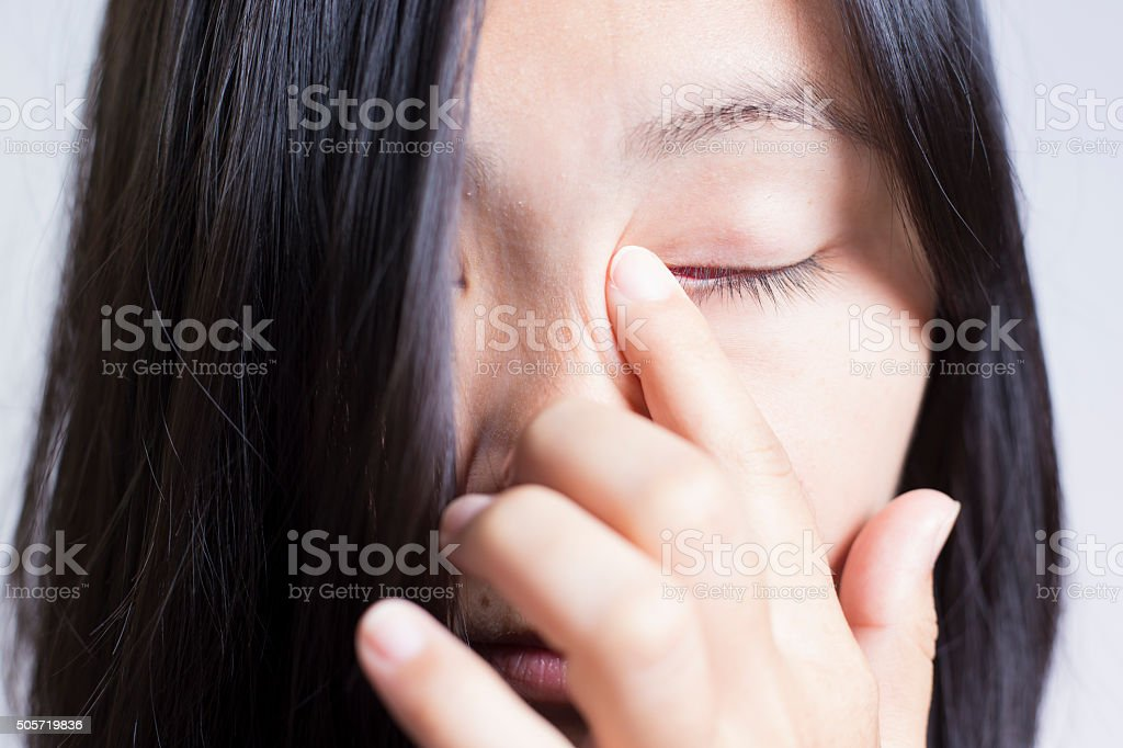 Woman Rubbing Her Eye stock photo