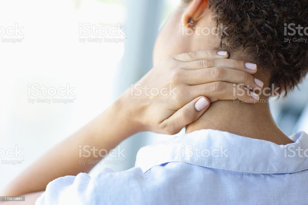 Woman rubbing sore neck stock photo
