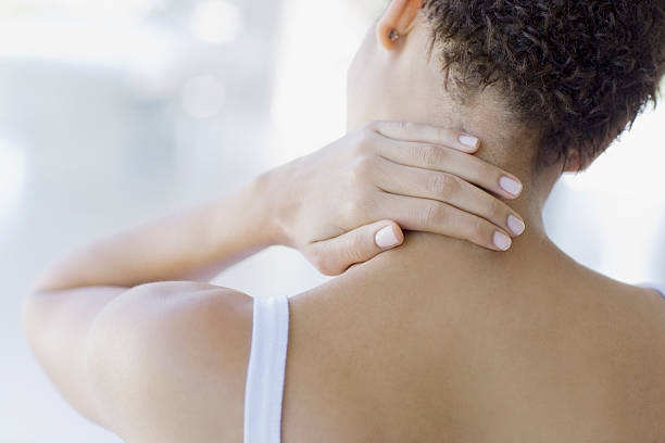 Woman rubbing sore neck  human neck stock pictures, royalty-free photos & images