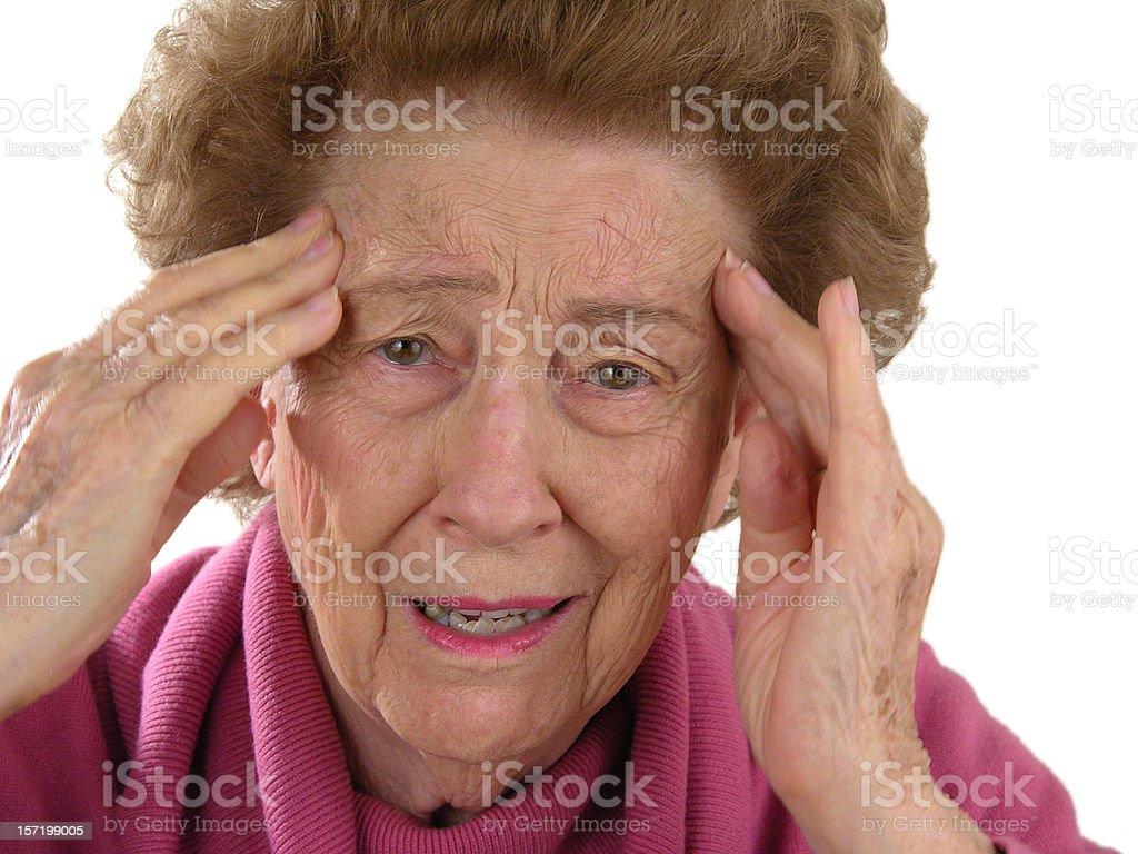 Woman rubbing temples stock photo