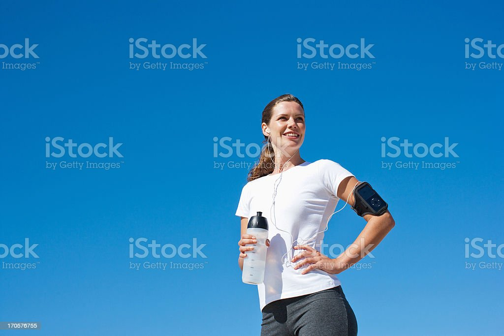 Woman runner drinking from water bottle royalty-free stock photo