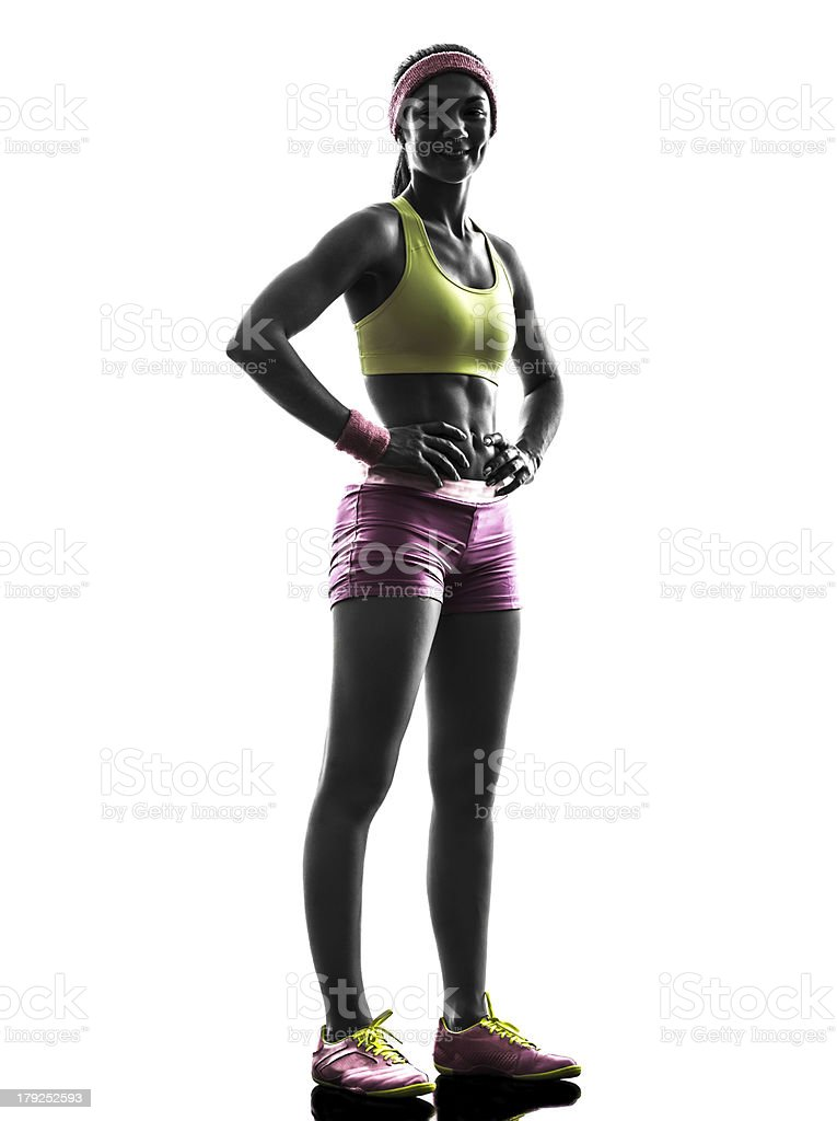 woman runner exercising posing  silhouette stock photo