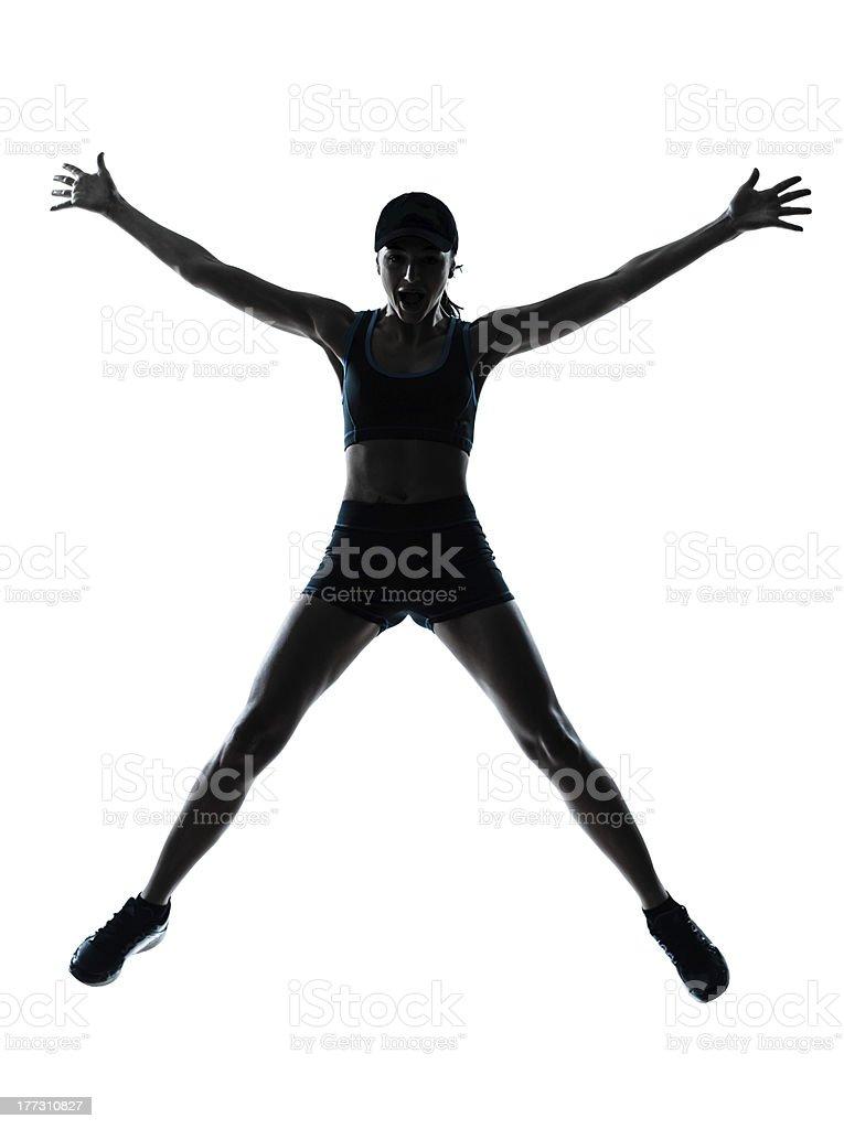woman runner jogger jumping happy royalty-free stock photo