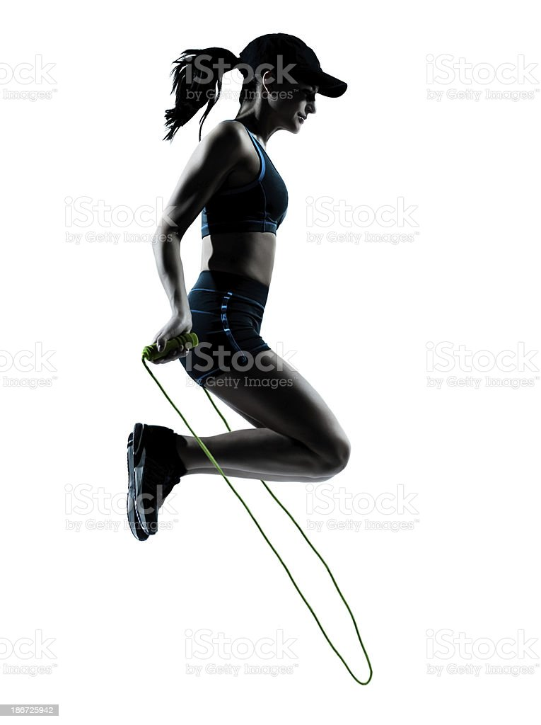 woman runner jogger jumping rope stock photo